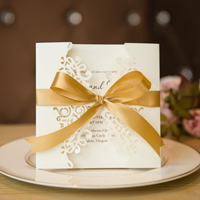 elegant laser cut wedding invitations with gold satin ribbon swws006