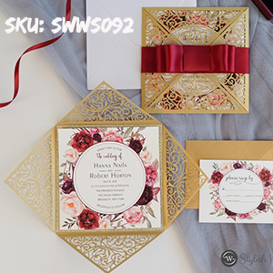 gold laser cut wrap with burgundy floral wedding invites and satin ribbon bow SWWS092