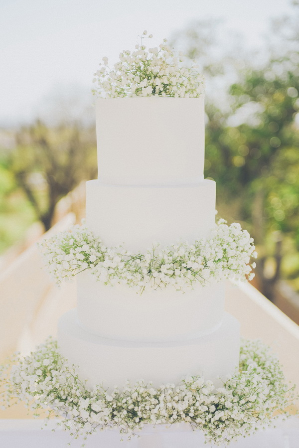 four-tiered-white-wedding-cake-with-baby-breath