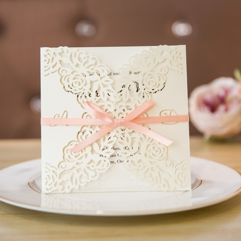 monogram cream and pink wedding invitations