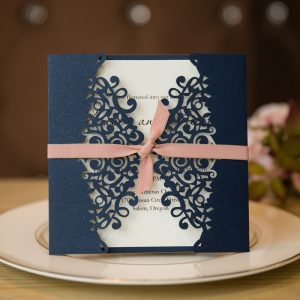 navy blue and blush pink laser cut invitations