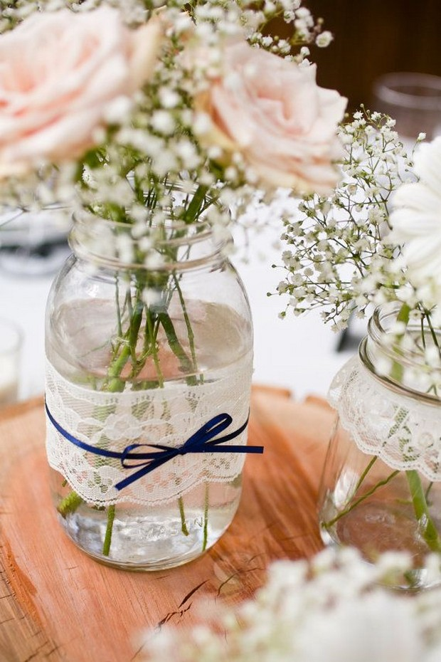 rose-and-babys-breath-lace-wrapped-mason-jars-with-navy-ribbon