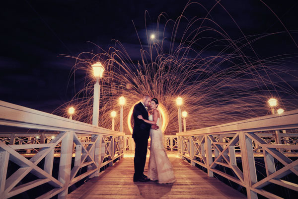 serene, romantic moment with dramatic fire show in the background