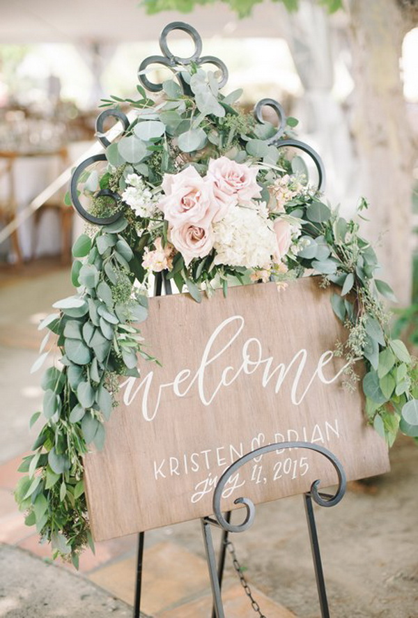 welcome-wooden-wedding-sign-with-roses-and-greenery-leaves