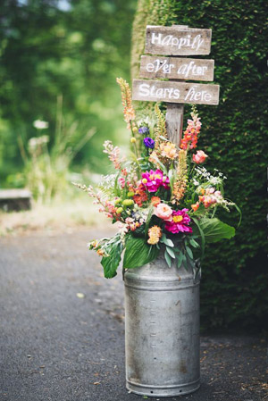 Perfect Way to Use Florals for Your Rustic Wedding Signs