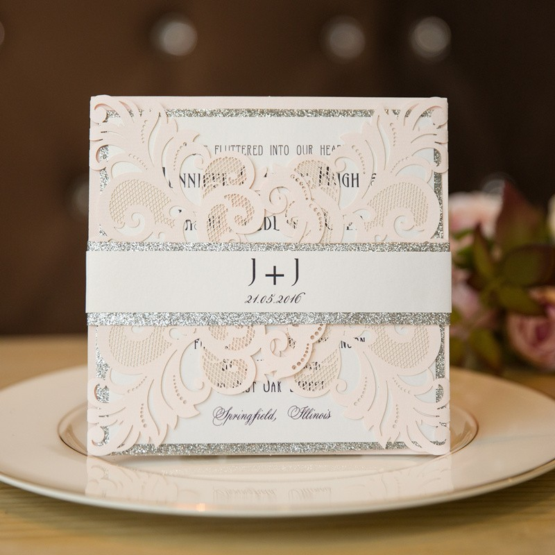 blush pink and silver laser cut wedding invitation cards