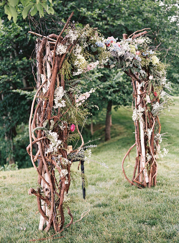 florals and branches wedding ceremony arbor