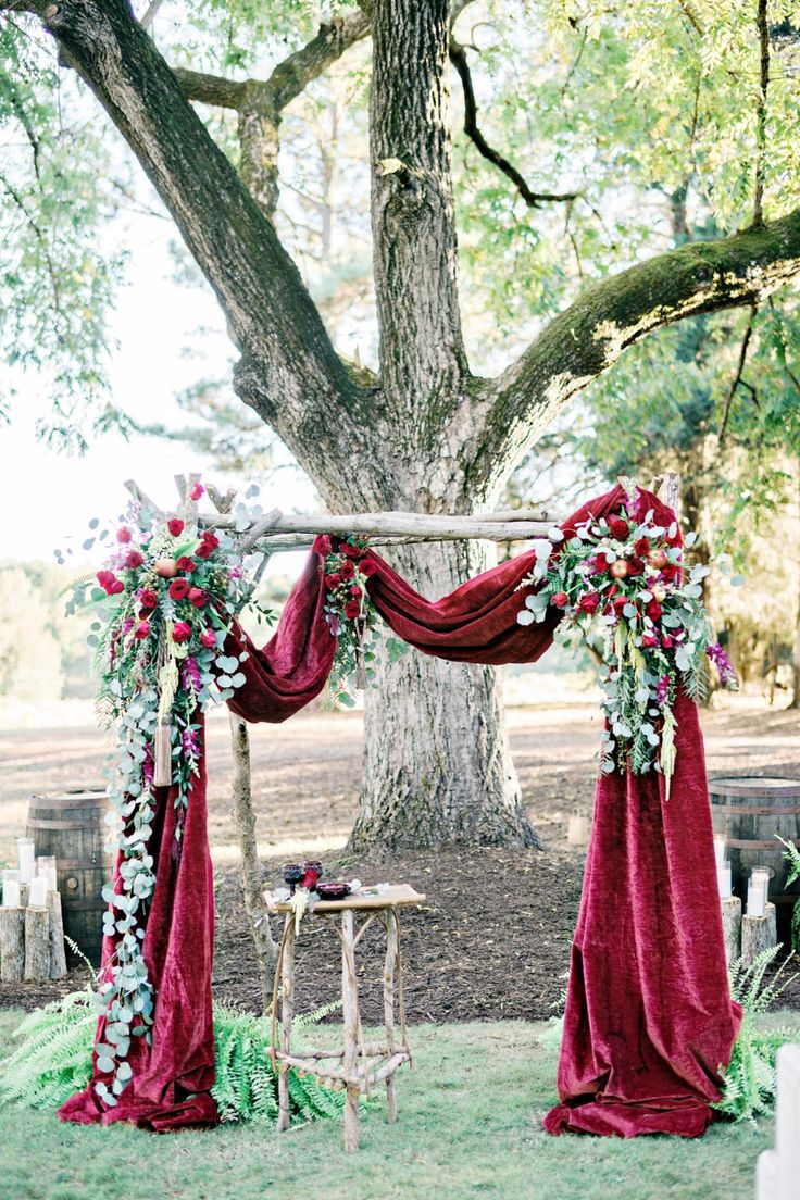 simple outdoor wedding ceremony decor consisted of greenery garland