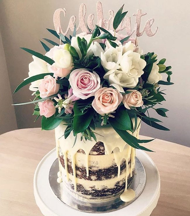 Gorgeous Naked Drip Cake Topped with Fresh Flowers