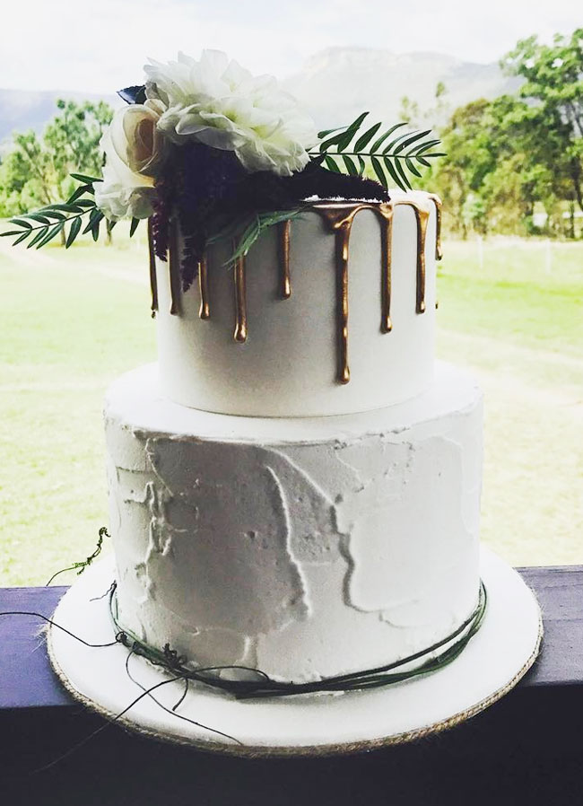 Rustic Iced Wedding Cake with Rose Gold Drip and Topped with Fresh Flowers