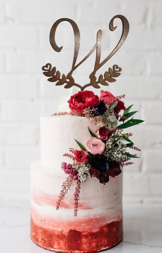 burgundy flroal wedding cakes with monogram cake topper