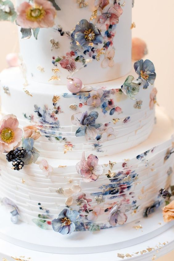 chic blue and blush paint smudge wedding cake
