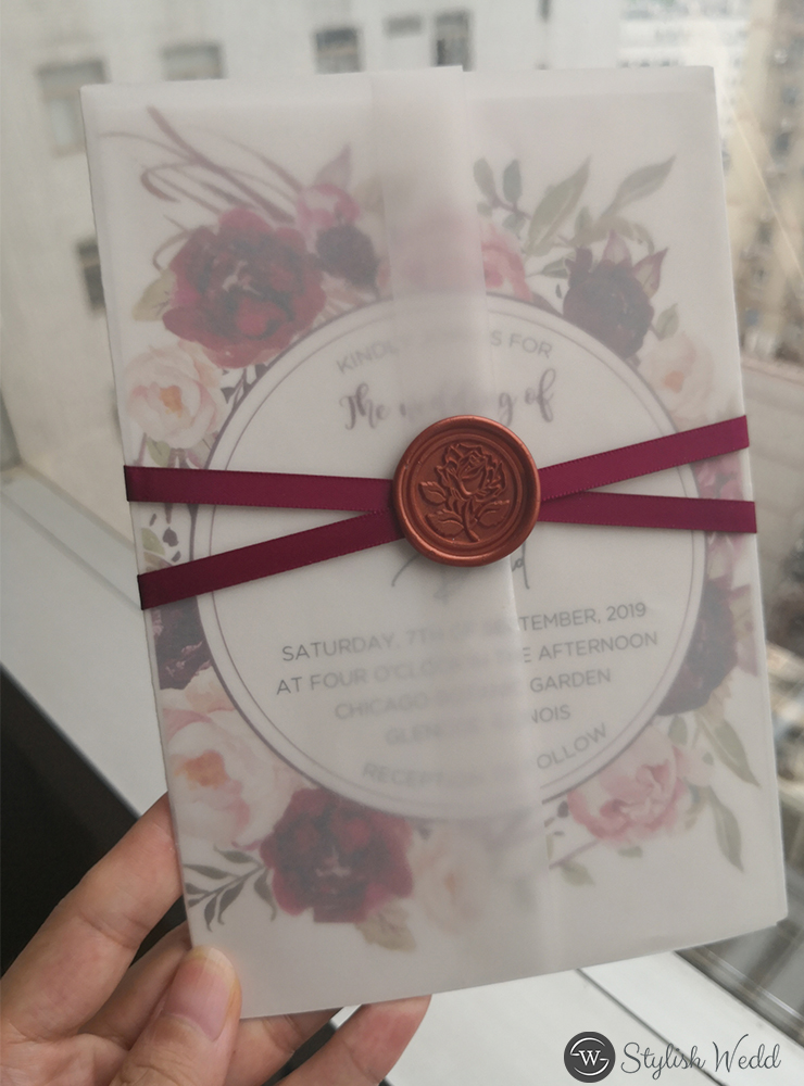 elegant burgundy flower wedding invitation with printed vellum paper wrap and burgundy ribbon wax seal
