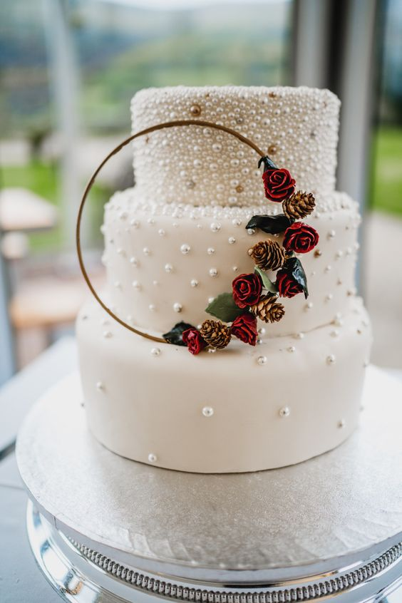 pearl wedding cake with burgundy floral for elegant wedding