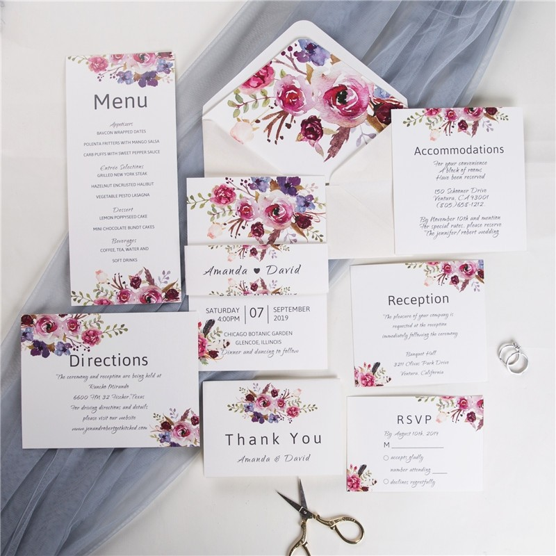 pink and purple floral wedding invitation with vellum paper and belly band
