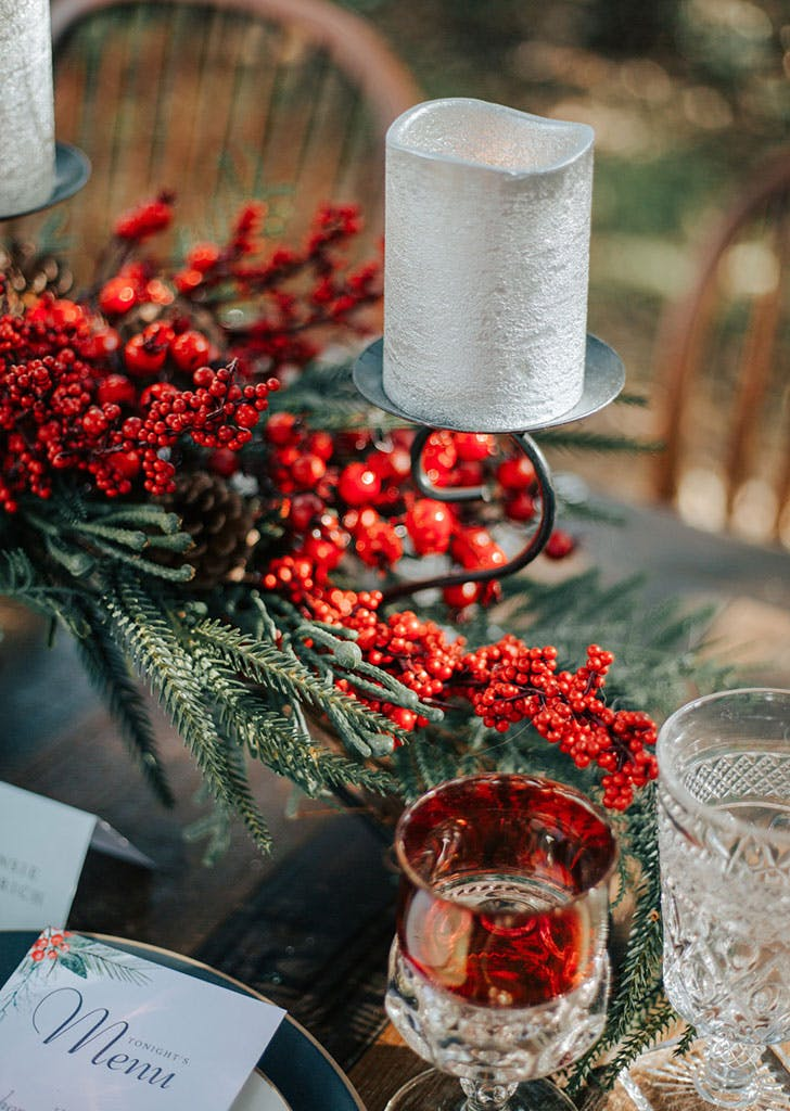 christmas wedding ideas for decorate candleholders with red berry bunches