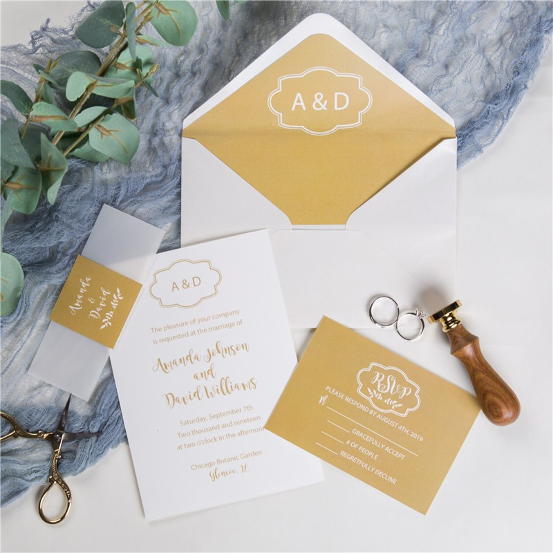simple yellow monogram wedding invitations with vellum paper belly band and tags