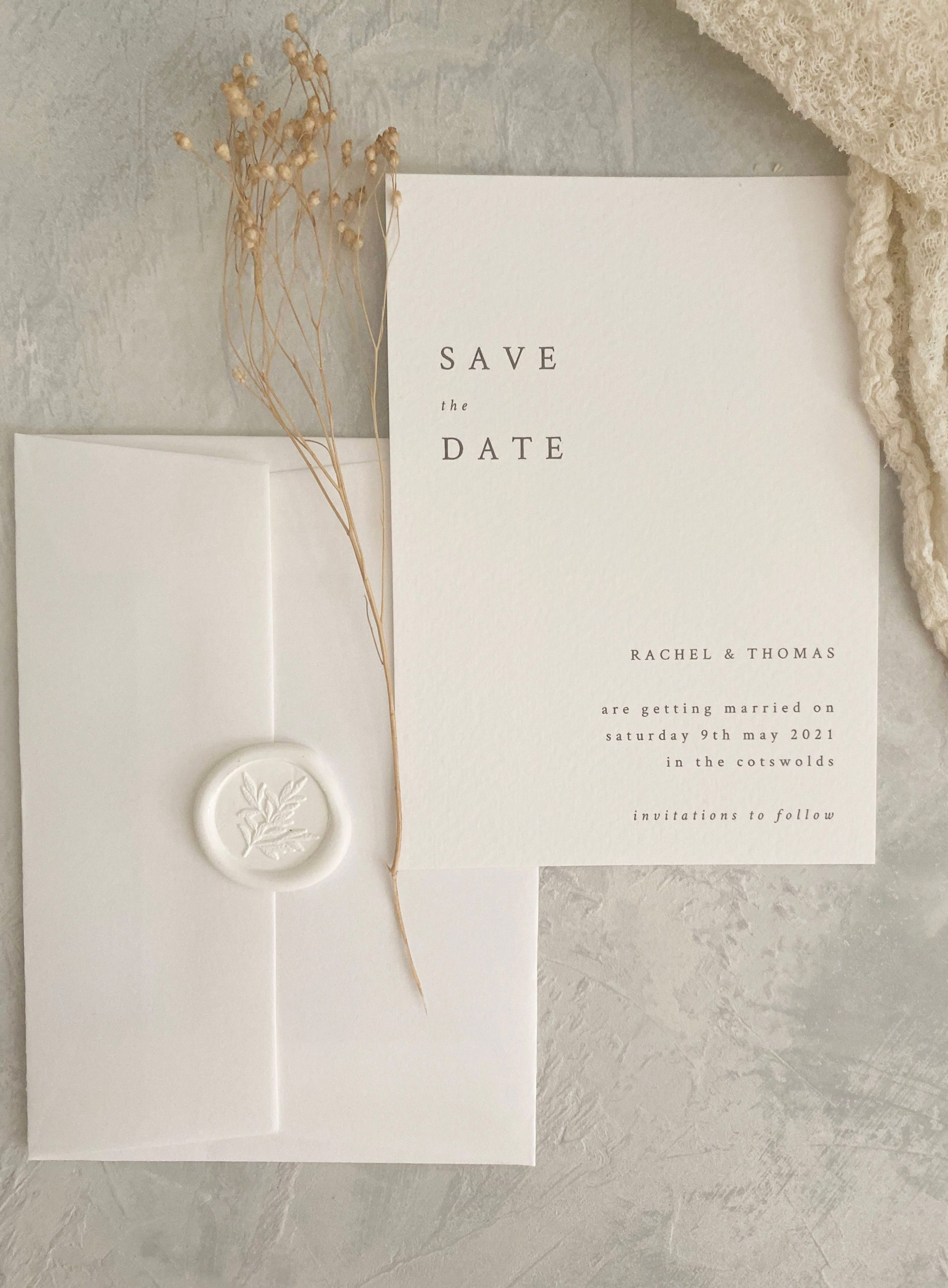 modern save the date card with envelope and floral waxs